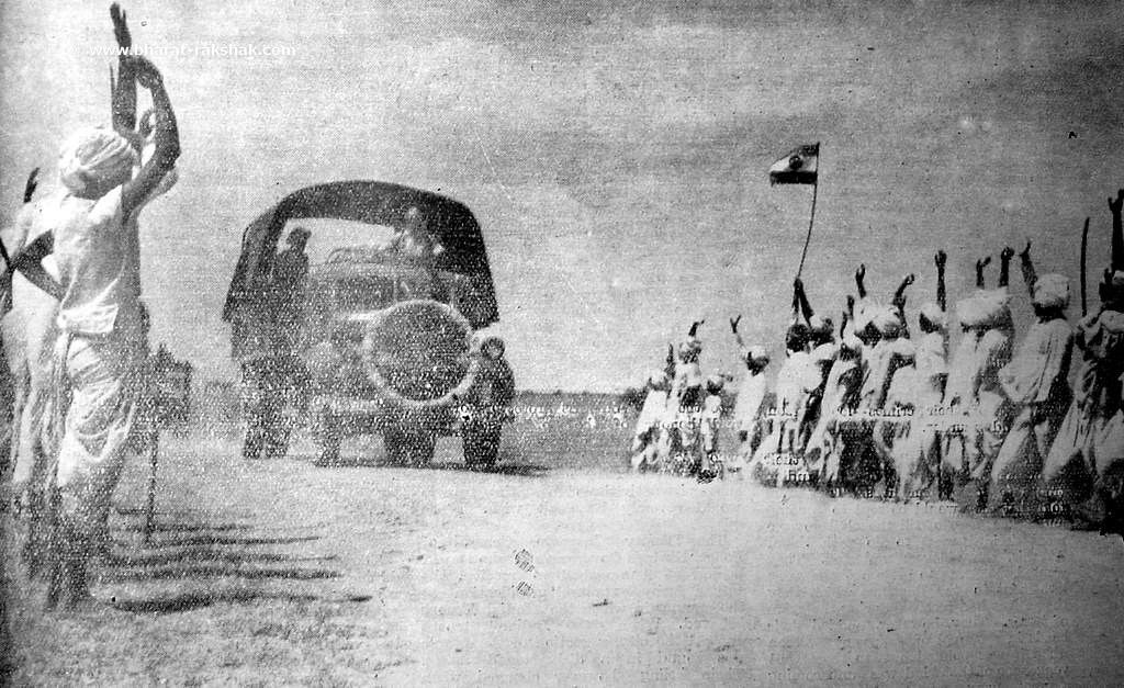 An Indian Army motor column is cheered by villagers on its way to Naldurg, Hyderabad.